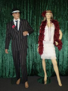 Men's pinstripe 20's suit and ladies white 20's dress