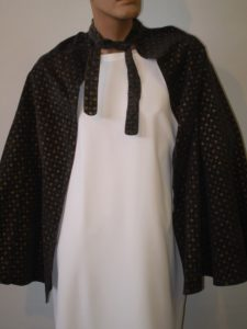 Black cape with gold print