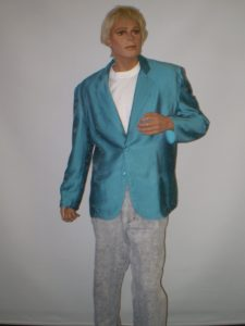 Blue eighties jacket, white t shirt and grey 80s pants