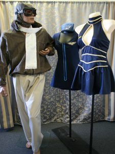 Two Air hostess costumes and old fashioned pilot or aviator costume