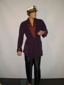 Hugh Hefner costume includes smoking jacket and captains hat