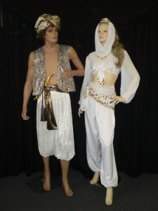 Gold and white men's and ladies costumes
