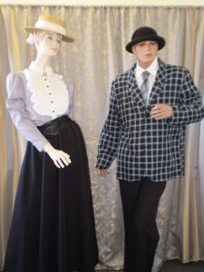 Male and female Edwardian day wear , old fashioned school teacher costumes