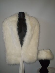 White fur stole and fur hat