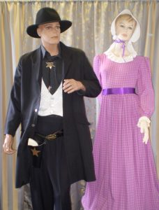 1800's western sheriff and purple frontiers lady