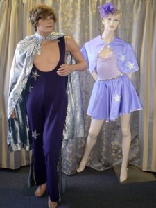 Vintage circus Male and Female Acrobat costumes in purple.