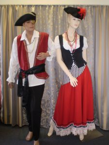 Pirate costumes, male and female in red, black and white