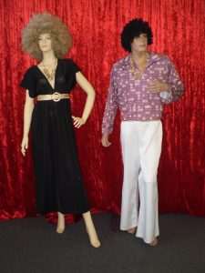 60s 70s costumes for a disco couple, black dress and jumbo afro, body shirt and white flares