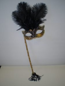 Black & gold masquerade mask on stick