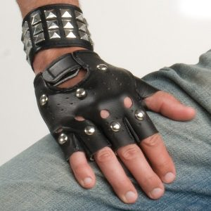 Studded gloves and studded wristbands.